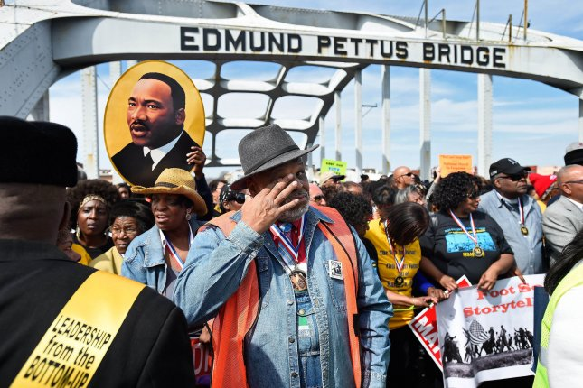 Spyra Gordon, one of the original marchers, wipes his eyes after ceremoniously crossing the historic Edmund Pettus Bridge with thousands of others to remember the violent clash between civil rights activists and police during the March on Selma 50 years ago in Selma, Alabama, March 8, 2015. Photo by David Tulis/UPI