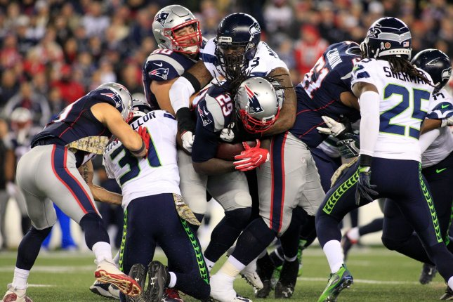 New England Patriots running back LeGarrette Blount (29) is wrapped up by Seattle Seahawks defensive tackle Tony McDaniel (93) on a carry in the second quarter at Gillette Stadium in Foxborough, Massachusetts on November 13, 2016. Photo by Matthew Healey/ UPI