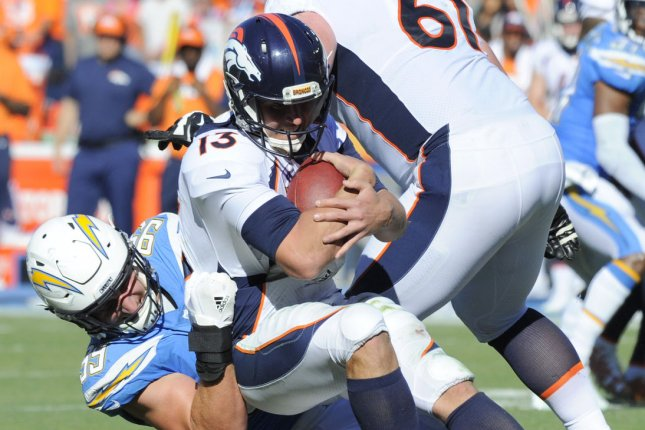 Los Angeles Chargers Joey Bosa sacks Denver Broncos quarterback Trevor Siemian in the second half at the StubHub Center in Carson, California on October 22, 2017. The Chargers won 21 to 0. Photo by Lori Shepler/UPI
