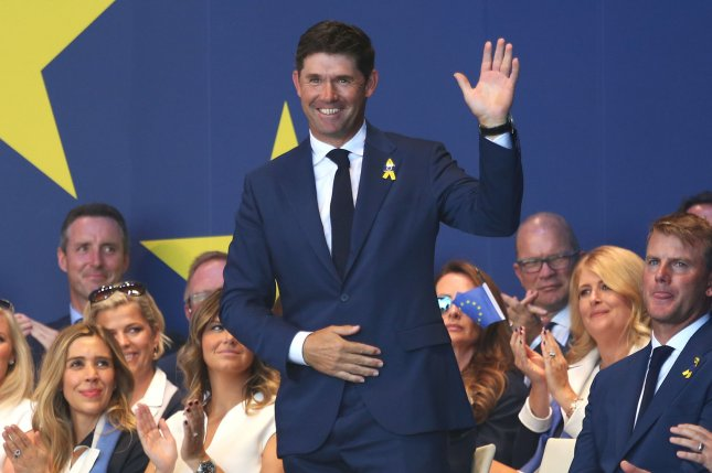 Team Europe vice captain Padraig Harrington acknowledges the crowd during the Ryder Cup 2018 Opening Ceremony on September 26 at Le Golf National in Guyancourt near Paris. Photo by David Silpa/UPI