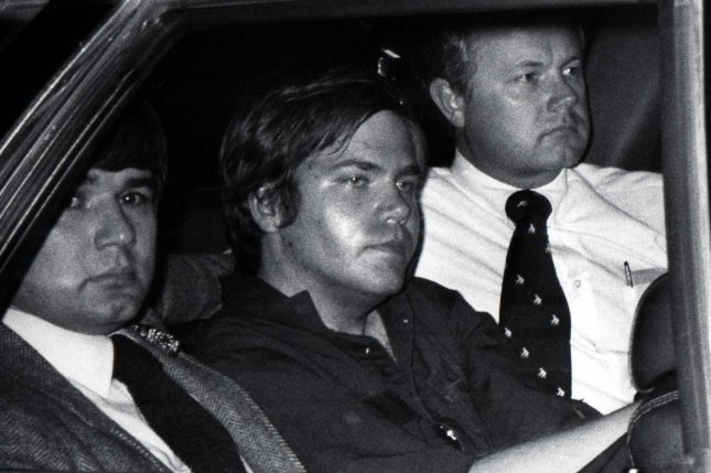 John Hinckley Jr. is flanked by federal agents as he is driven away from court April 10, 1981. On March 30, 1981, John Hinckley Jr. shot U.S. President Ronald Reagan outside a Washington hotel. UPI File Photo