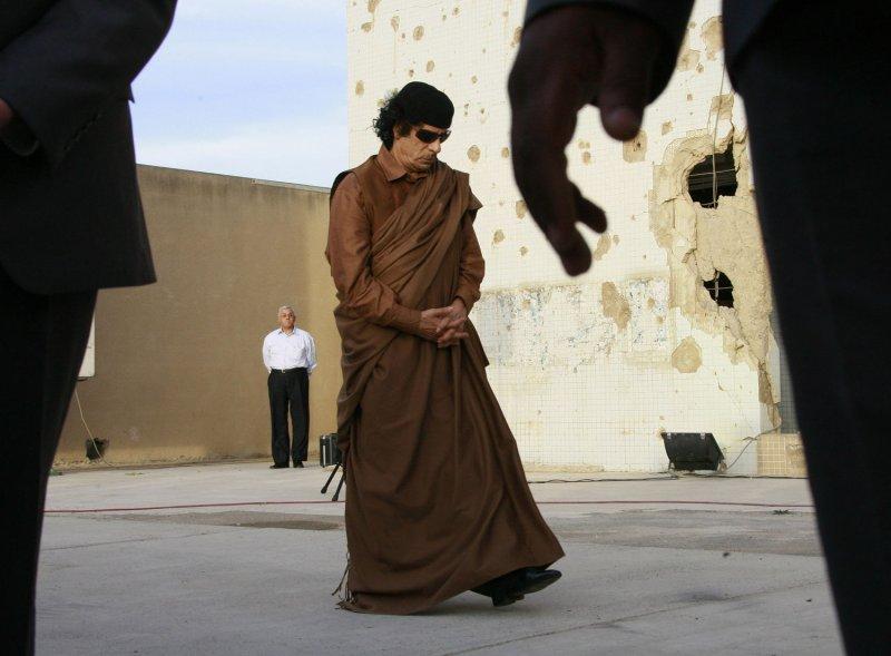 Libyan Leader Moammar Gadhafi awaits the arrival of Russian President Vladimir Putin in Tripoli on April 16, 2008. Gadhafi is allegedly hiding weapons beneath Roman ruins. (UPI Photo/Anatoli Zhdanov)