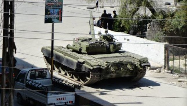 A Syrian Army tank rolls down a street in Duma, a suburb of Damascus, Syria, April 6, 2012. UPI