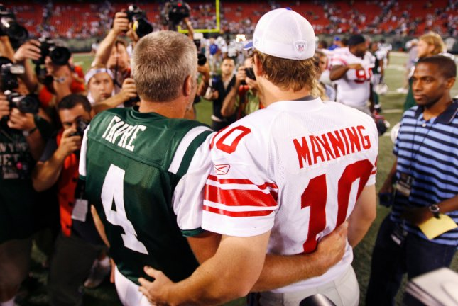 New York Giants Eli Manning and New York Jets Brett Favre greet each other on the field after the game at Giants Stadium in East Rutherford, New Jersey on August 23, 2008. The Jets defeated the Giants 10-7. (UPI Photo/John Angelillo) .