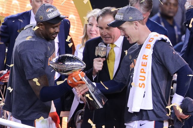 MVP Denver Broncos' Von Miller (L) hands the Vince Lombardi Trophy to QB Peyton Manning after Super Bowl 50 in Santa Clara, California on February 7, 2016. The Denver Broncos defeated the Carolina Panthers 24-10. Photo by Khaled Sayed/UPI