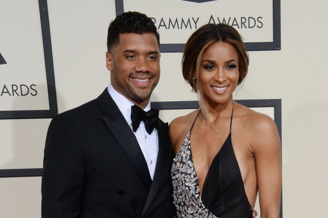 Russell Wilson (L) and girlfriend Ciara at the Grammy Awards on February 15. The couple brought Ciara's son to Dodger Stadium on Tuesday. File Photo by Jim Ruymen/UPI