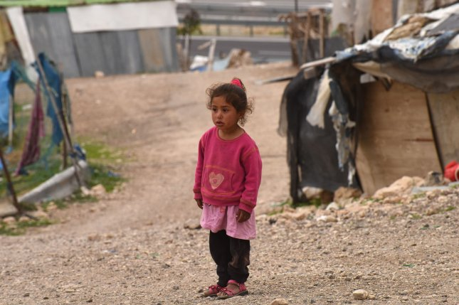 A Palestinian girl stands near a hut in the Khan Al-Ahmar encampment in the central West Bank on Wednesday. The Israeli Civil Administration distributed demolition orders this week to the village, located in Area C, which is under full Israeli civil and military control. Khan Al-Ahmar is surrounded by Israeli settlements outside of Jerusalem in the Judean Desert. Photo by Debbie Hill/UPI