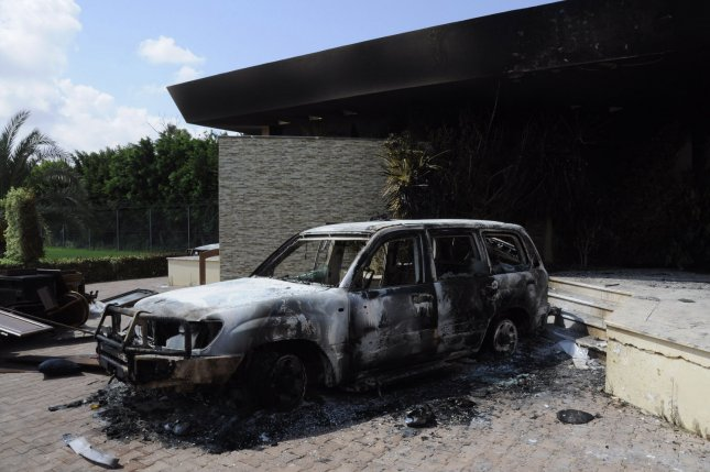 A burned building and vehicle are seen at the United States consulate in Benghazi, Libya, on September 12, 2012, one day after armed men stormed the compound and killed U.S. Ambassador Christopher Stevens and three others. File Photo by Tariq AL-hun/UPI
