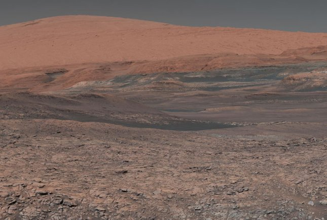 A composite image taken by the Mars Curiosity rover in January shows Mount Sharp on the surface of the red planet. Scientific experts told Senate lawmakers Wednesday NASA needs to be focusing more on a manned mission to Mars than a return to the moon. Photo courtesy NASA/UPI