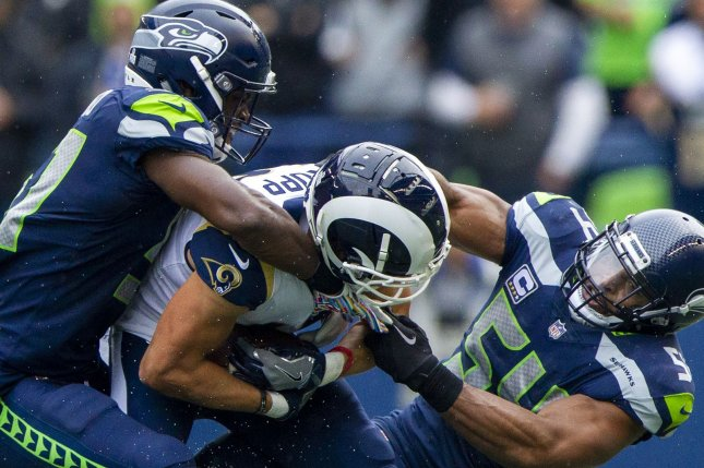 Los Angeles Rams receiver Cooper Kupp tries to break free from a tackle during a game against the Seattle Seahawks on October, 7 2018. Photo by Jim Bryant/UPI