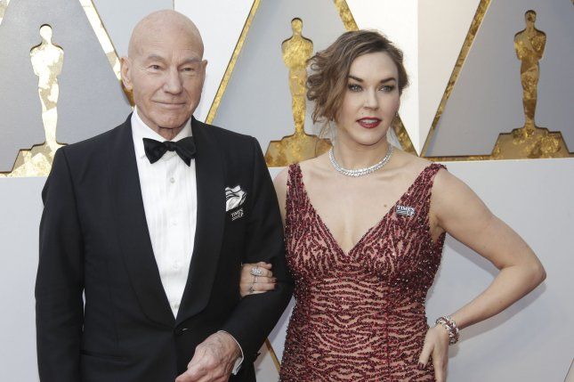Patrick Stewart (L) and his wife Sunny Ozell. Stewart portrays Merlin in the new trailer for The Kid Who Would Be King alongside Rebecca Ferguson. File Photo by John Angelillo/UPI