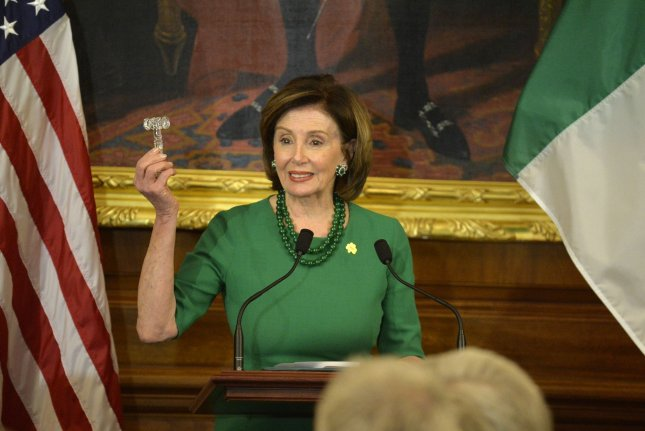The House passed the legislation early Saturday after intense negotiations between Speaker Nancy Pelosi and Treasury Secretary Steven Mnuchin. Photo by Mike Theiler/UPI