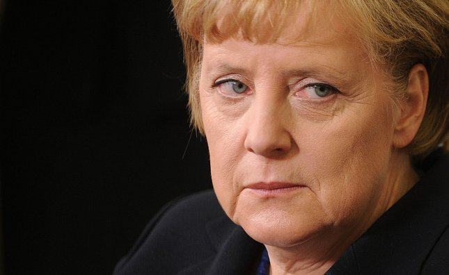German Chancellor Angela Merkel, looking very unfunny. UPI/Olivier Douliery/Pool