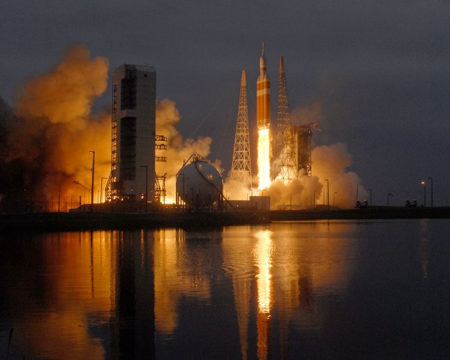 A United Launch Alliance Delta IV Heavy launches NASA's Orion Spacecraft at 7:05 AM on its Exploration Flight Test from Launch Complex 37 at the Cape Canaveral Air Force Station, Florida on December 5, 2014. The unmanned mission will test the systems on NASA's newest spacecraft during a four and a half hour, two orbit flight. NASA's plans for Orion include flying future manned missions on voyages to deep space exploring asteroids and eventually Mars. UPI / Joe Marino-Bill Cantrell)