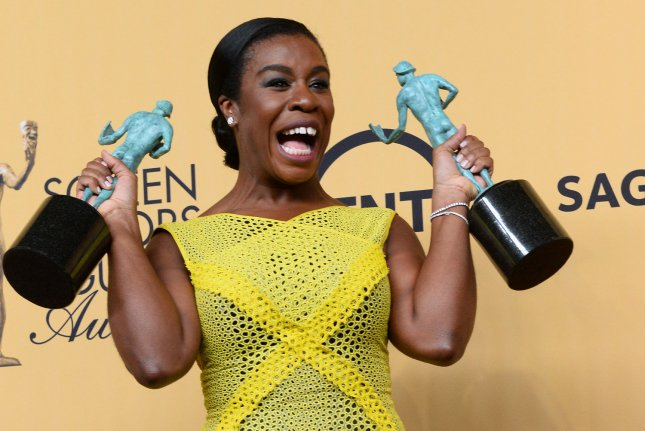 Uzo Aduba poses in the press room with the awards for outstanding ensemble in a comedy series and outstanding female actor in a comedy series for Orange is the New Black at the 21st annual SAG Awards held at the Shrine Auditorium in Los Angeles on January 25, 2015. The Screen Actors Guild Awards will be broadcast live on TNT and TBS. Photo by Jim Ruymen/UPI