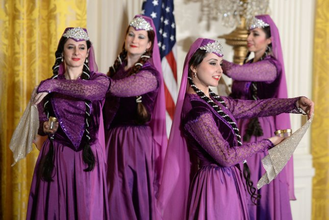 The Silk Road Dancers perform as the Persian New Year called Nowruz is observed in the East Room of the White House on March 11. The holiday is 3,000 years old and is celebrated by diverse ethnic communities globally but mainly in Iran and Afghanistan. Photo by Pat Benic/UPI