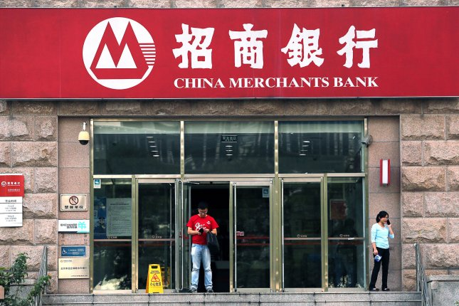 China's Communist Party has issued a long-awaited plan for overhauling bloated state industries that would retain the party's dominance in the economy. Pictured, a China Merchants Bank branch in Beijing on Sept. 14, 2015. Photo by Stephen Shaver/UPI