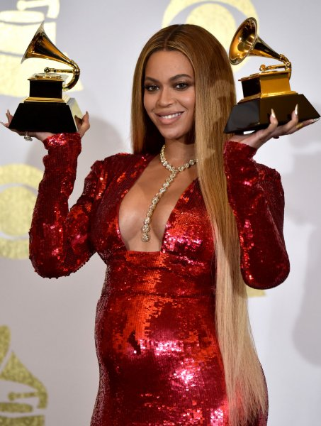 Beyoncé appears backstage with her awards for Best Music Video for Formation and Best Urban Contemporary Album for Lemonade during the 59th annual Grammy Awards in Los Angeles on February 12. Beyoncé's family and friends threw her a baby shower Saturday. File Photo by Christine Chew/UPI