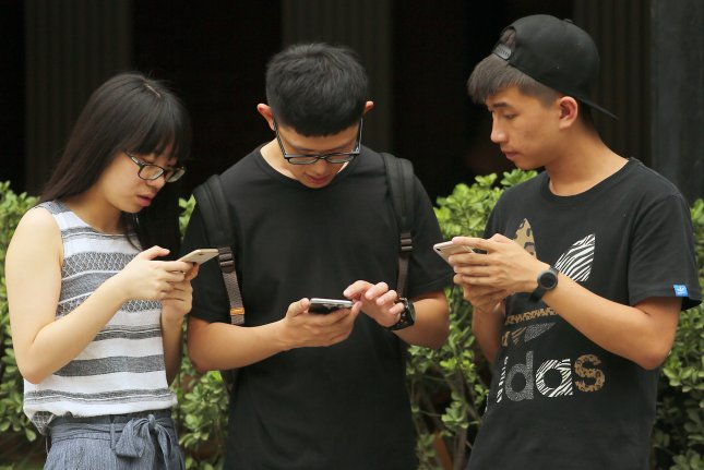 A recent survey found that millennials preferred lifestyle changes to treat acute or chronic pain from computer and smartphone use over taking opioid medications. Photo by Stephen Shaver/UPI