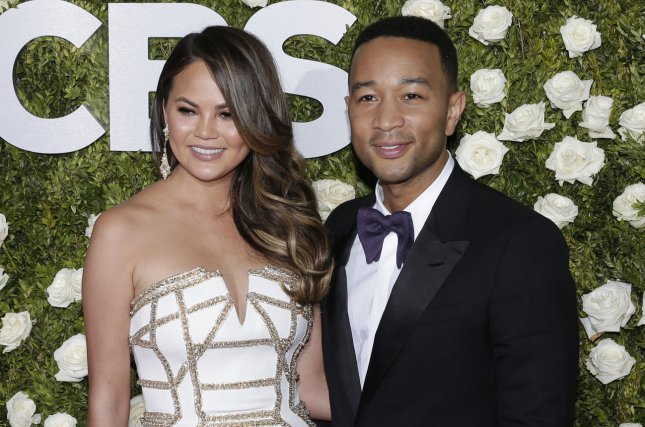 Chrissy Teigen (L), pictured with John Legend, said daughter Luna is obsessed with dolls but not quite ready to welcome a sibling. File Photo by John Angelillo/UPI