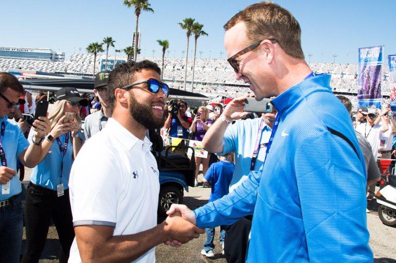 Darrell Wallace Jr. (L) and Peyton Manning chat prior to the Daytona 500 on February 18 at Daytona International Speedway in Daytona, Fla. Photo by Edwin Locke/UPI