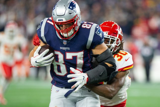 New England Patriots tight end Rob Gronkowski tries to escape a tackle from Kansas City Chiefs safety Josh Shaw during their game at Gillette Stadium in Foxborough, Massachusetts on October 14, 2018. Photo by Matthew Healey/UPI