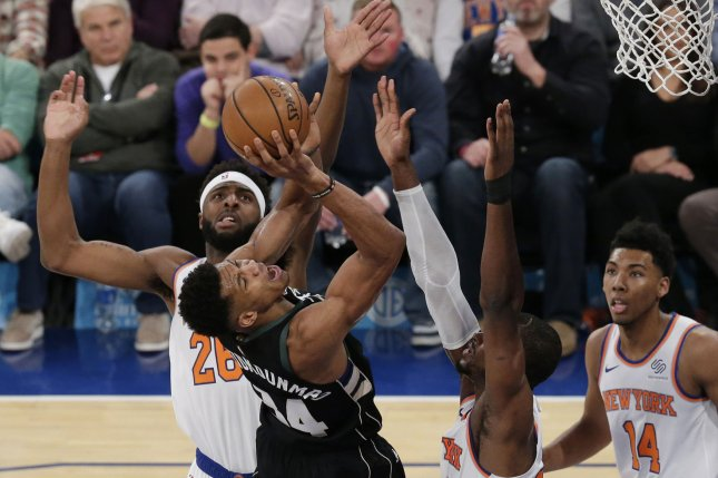 New York Knicks defender Mitchell Robinson puts his hands in the face of Milwaukee Bucks forward Giannis Antetokounmpo (34) as Antetokounmpo drives to the basket on December 1, 2018 at Madison Square Garden in New York City. Photo by John Angelillo/UPI