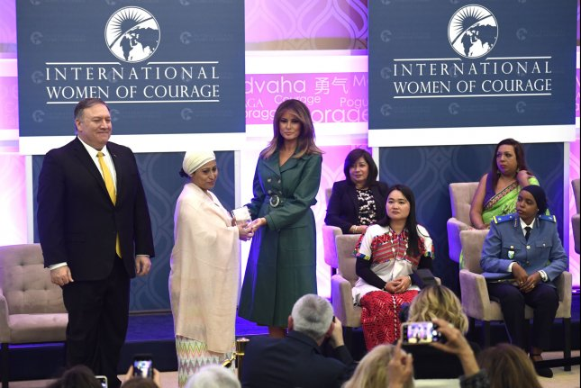 First lady Melania Trump and Secretary of State Mike Pompeo honor Bangladesh's Razia Sultana Thursday as a winner of the 2019 International Women of Courage Award, at the State Department. Photo by Mike Theiler/UPI