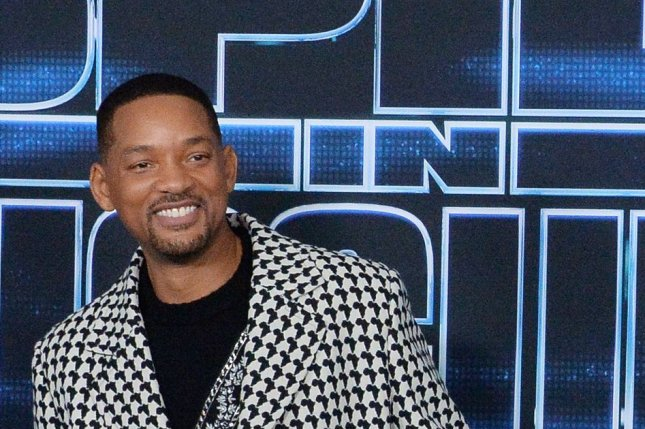 Will Smith is teaming up with Kevin Hart for a remake of Planes, Trains and Automobiles at Paramount. File Photo by Jim Ruymen/UPI