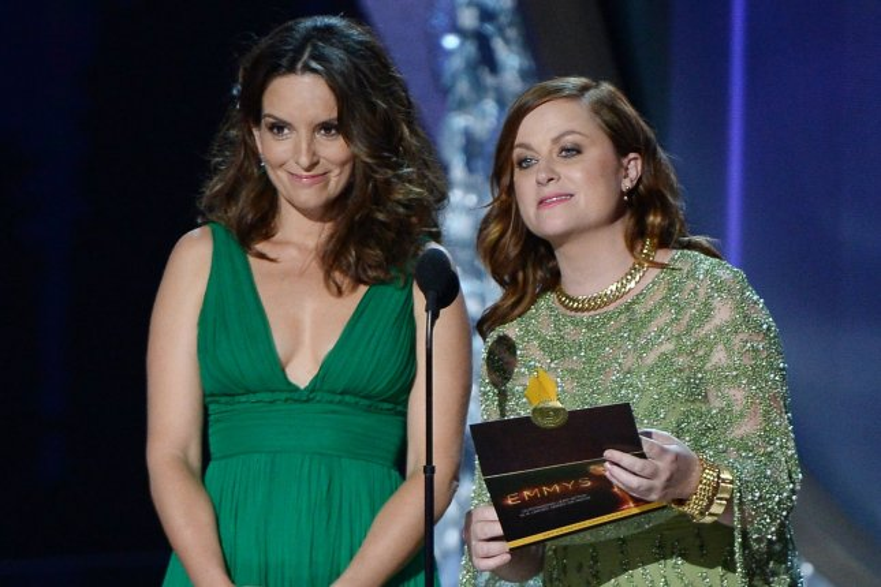 Tina Fey (L) and Amy Poehler are hosting the 2021 Golden Globe Awards on Sunday. File Photo by Jim Ruymen/UPI