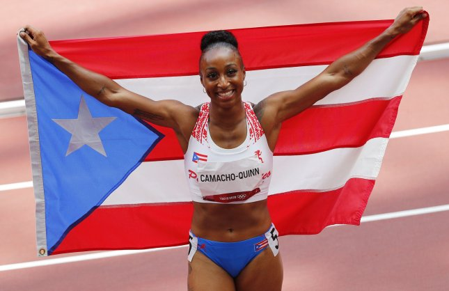 Puerto Rico's Jasmine Camacho-Quinn celebrates after winning the gold medal in the women's 100-meter hurdles during the Tokyo Summer Olympics in Tokyo, Japan, on Monday. Photo by Bob Strong/UPI