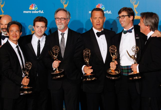 Producer Tom Hanks (3rd R) holds his Emmy Award for outstanding miniseries for The Pacific as he is surrounded by the cast at the 62nd Primetime Emmy Awards at the Nokia Theatre in Los Angeles on August 29, 2010. UPI/Lori Shepler