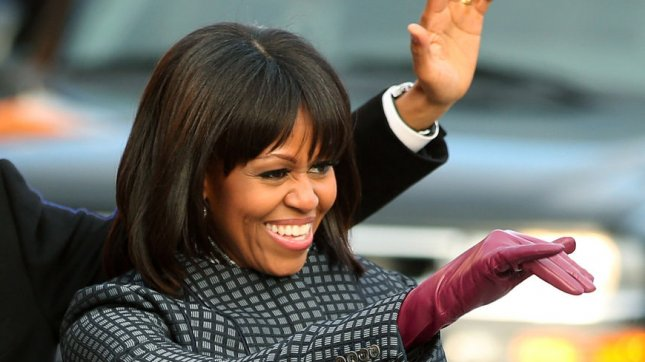 President Barack Obama and First Lady Michelle Obama wave during the Inaugural Parade after his public inauguration ceremony in Washington, D.C. on January 21, 2013. President Obama was sworn-in for a second term as the 44th President of the United States. UPI/Chip Somodevilla/pool