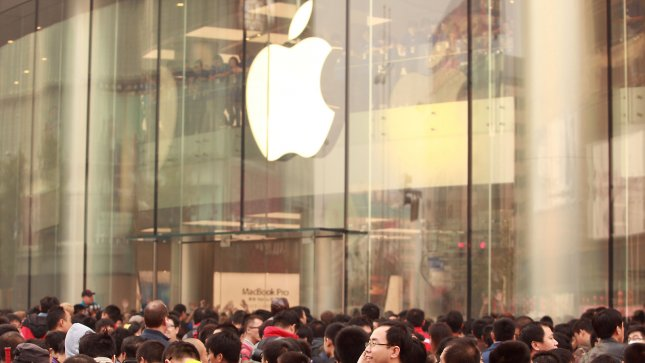 Hundreds of Chinese wait for China's newest (sixth) and Asia's largest Apple store, a sprawling 3-floor complex, to open in central Beijing, not far from Tiananmen Square, on October 20, 2012. Apple's iPhones, iPads and computers are very popular with Chinese, but with only five authorized stores in the country copy cats have sprung up to meet the demand. China is now the second-biggest market for Apple after the United States, but the company has also faced frequent criticism for the working conditions in which its products are produced in China. UPI/Stephen Shaver