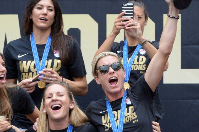 The United States of America women's soccer team lead by Abby Wambach (holding trophy) celebrate their 2015 Women's World Cup victory during a rally at Microsoft Square in Los Angeles on July 7, 2015. Photo by Jim Ruymen/UPI