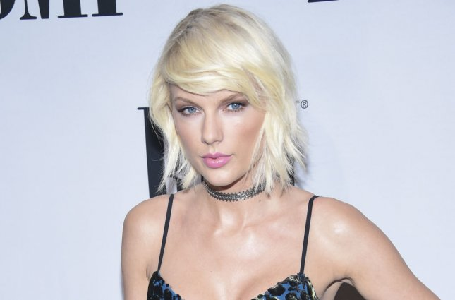 Taylor Swift attends the 64th Annual BMI Pop Awards on May 10, 2016. Swift, along with singers Katy Perry, Demi Lovato and Lorde, has shared her thoughts on Twitter concerning Monday's suicide bomber attack at an Ariana Grande concert. File Photo by Phil McCarten/UPI