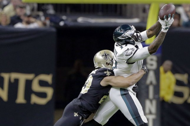 Philadelphia Eagles wide receiver Alshon Jeffery (17) snags a Nick Foles pass as New Orleans Saints cornerback Marshon Lattimore (23) makes the tackle during the divisional round of the NFC playoffs with the Philadelphia Eagles on Sunday at the Mercedes-Benz Superdome in New Orleans. Photo by AJ Sisco/UPI