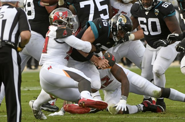 Jacksonville Jaguars quarterback Gardner Minshew (15) fumbles after being sacked during the fourth quarter Sunday at TIAA Bank Field in Jacksonville, Florida. The Tampa Bay Buccaneers defeated the Jaguars 28-11. Photo by Joe Marino/UPI