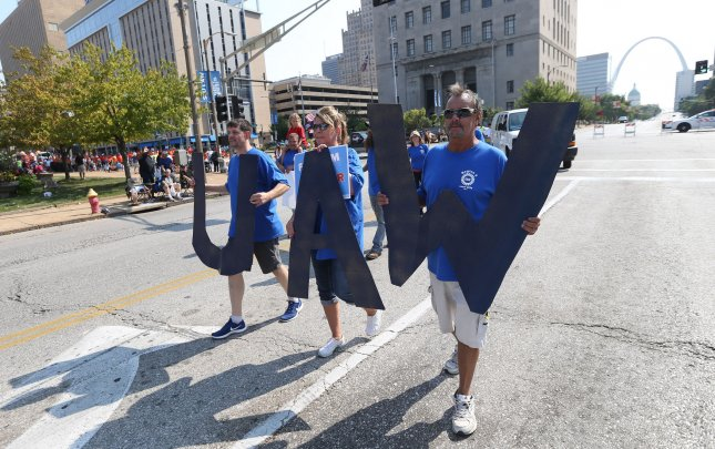 Members of the local United Auto Workers union, hold large UAW letters during the St. Louis Labor Day Parade in St. Louis. File Photo by Bill Greenblatt/UPI