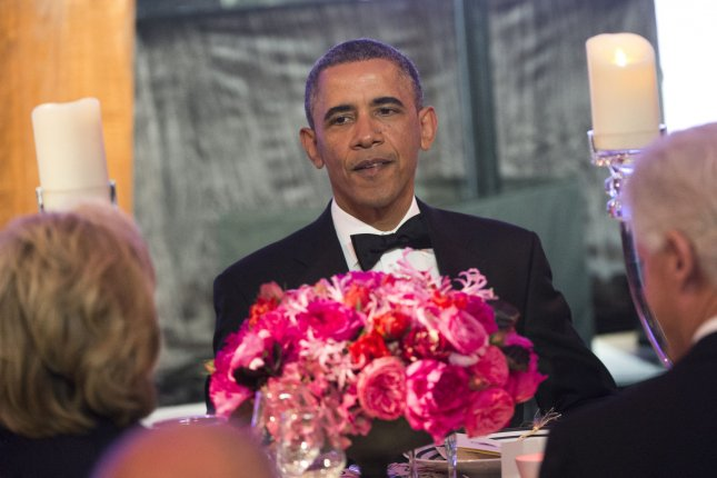 President Barack Obama eats dinner with recipients of the Medal of Freedom at the Smithsonian National Museum of American History on November 20, 2013 in Washington, D.C. UPI/Kevin Dietsch