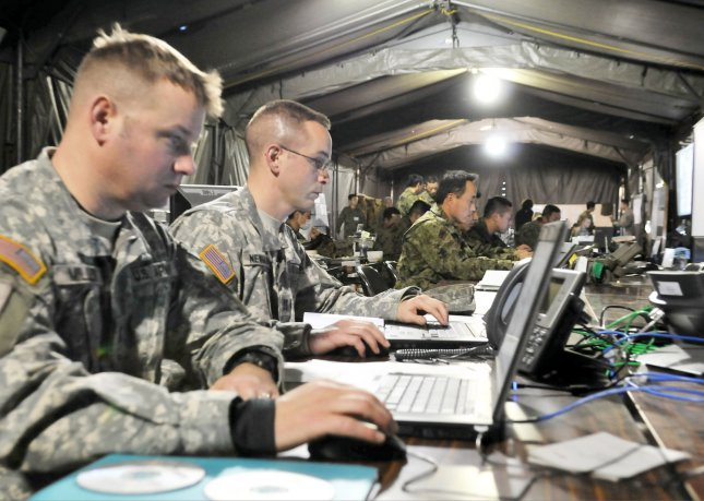 U.S. and Japanese soldiers follow computer simulations during joint command post exercise Yama-sakura59 at the Camp Kengun in Kumamoto prefecture, Japan, on January 27, 2011. UPI/Keizo Mori