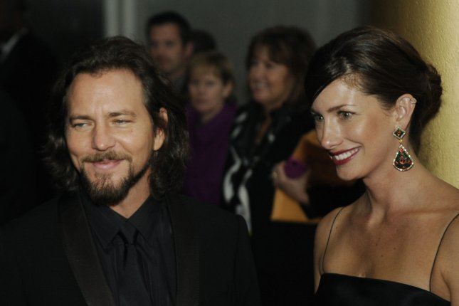 Eddie Vedder and his wife Jill McCormick arrive on the red carpet of the Kennedy Center Honors in Washington on December 6, 2009. Vedder was reportedly the intended recipient of a letter from a man attempting to contact his ex through the rocker. Photo by Alexis C. Glenn/UPI