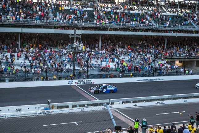 Kasey Kahne takes the checkered flag, winning the 2017 Brickyard 400, at the Indianapolis Motor Speedway on July 23, 2017 in Indianapolis, Indiana. Photo by Edwin Locke/UPI