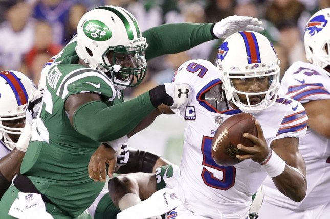 New York Jets Muhammad Wilkerson grabs the jersey of Buffalo Bills Tyrod Taylor in the first half in week 9 of the NFL at MetLife Stadium in East Rutherford, New Jersey on November 2, 2017. File photo by John Angelillo/UPI