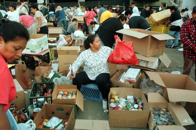Hundreds of volunteers whose family members were suffering the wrath of Hurricane Mitch box up food donations in a spontaneous effort, November 5, 1998, in a downtown Los Angeles parking lot. Hondurans who have had temporary protected status in the U.S. since 1999 will no longer have that designation starting in 2020. File Photo by Jim Ruymen/UPI