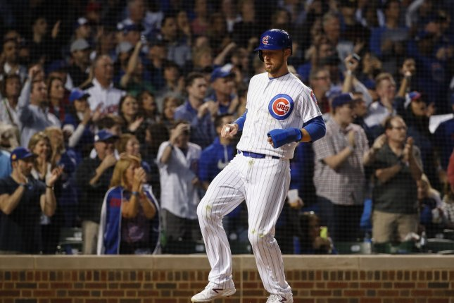 Chicago Cubs infielder Ben Zobrist scores against the St. Louis Cardinals earlier this month. Zobrist is away from the team amid a divorce from his wife, Julianna. File Photo by Kamil Krzaczynski/UPI