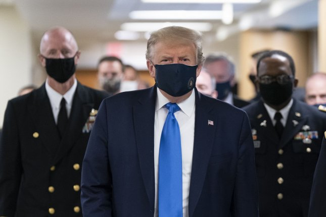 President Donald Trump arrives Saturday at Walter Reed National Military Medical Center in Bethesda, Md., to visit with wounded military members and front line coronavirus healthcare workers. President Trump wore a face mask in public for the first time. Photo by Chris Kleponis/UPI