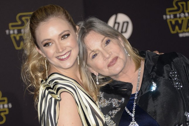 Billie Lourd (R) and her mother Carrie Fisher attend the premiere of Star Wars: The Force Awakens in December 2015. Lourd showed her son Kingston Fisher in Star Wars on Star Wars Day. File Photo by Phil McCarten/UPI
