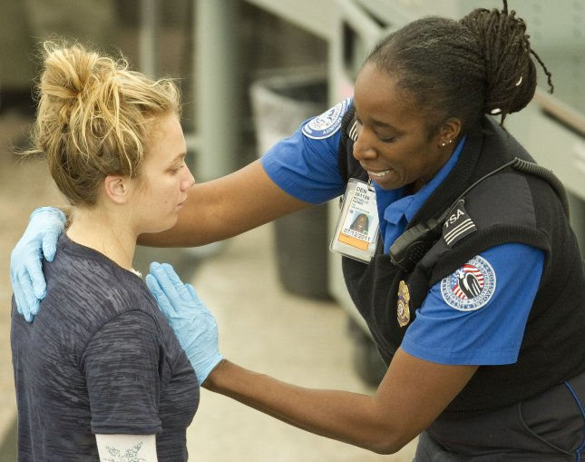 A Transportation Security Administration (TSA) agent conducts a pat down search in lieu of a full-body scan at Denver International Airport (DIA) the day before the Thanksgiving holiday on November 24, 2010 in Denver. UPI/Gary C. Caskey