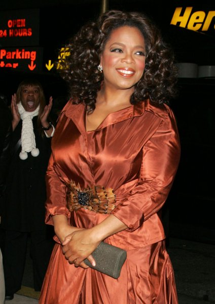 Oprah Winfrey arrives for the opening night gala of the 50th Anniversary of the Alvin Ailey Dance Company at City Center in New York on December 3, 2008. (UPI Photo/Laura Cavanaugh)